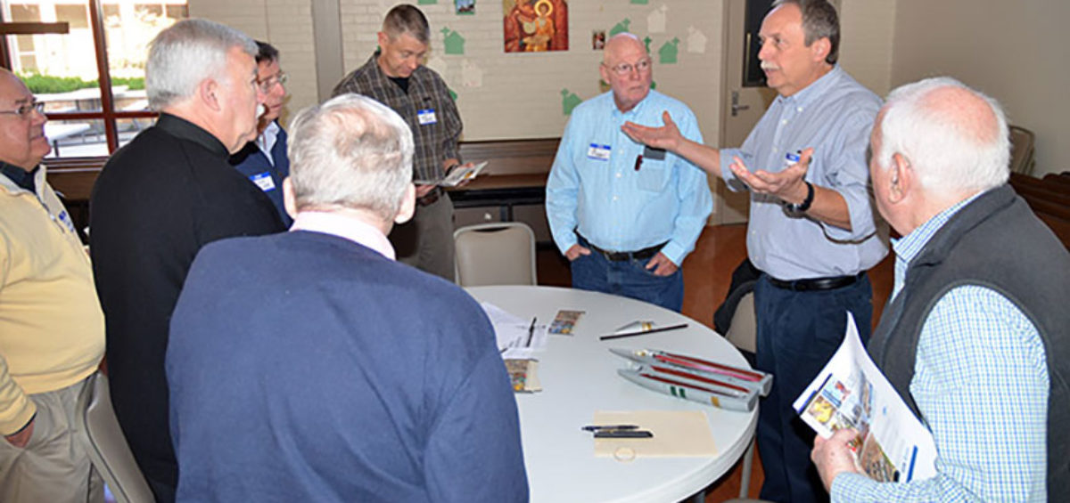 Members of St. Paul's Catholic Church men's club breakfast team ask questions of Site Project Manager Greg Mohrman following his presentation about the Pueblo Chemical Agent-Destruction Pilot Plant.