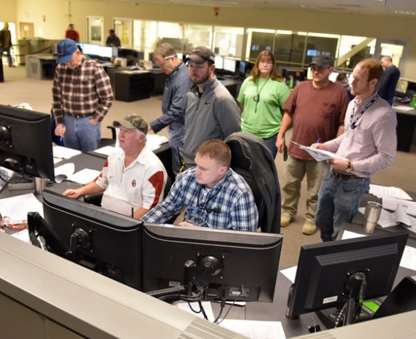 A multidisciplinary team participates in the Systemization Demonstration Procedure for the Energetics Neutralization System in the Blue Grass Chemical Agent-Destruction Pilot Plant's Control Room.