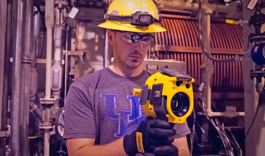 A technician takes a reading on a thermal camera to determine if Metal Parts Treater (MPT) electromagnetic fields create hot spots in the MPT Room at the Blue Grass Chemical Agent-Destruction Pilot Plant.