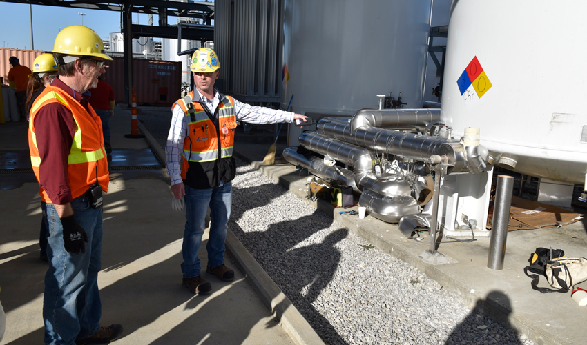 A safety engineer points out potential workplace hazards around a cryogenic nitrogen tank to a team of medical and industrial hygiene personnel at the Blue Grass Chemical Agent-Destruction Pilot Plant.