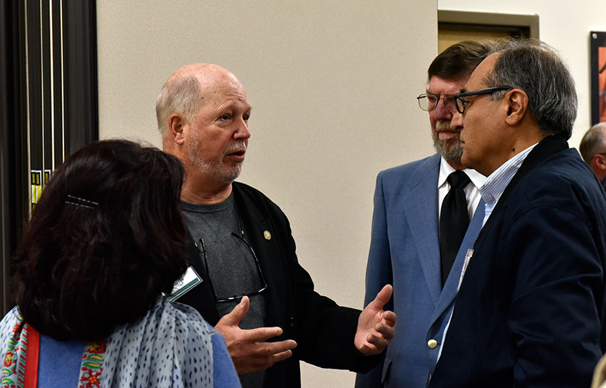 Craig Williams, co-chair, Chemical Destruction Community Advisory Board, speaks with Organisation for the Prohibition of Chemical Weapons Executive Council ambassadors at a Blue Grass Chemical Agent-Destruction Pilot Plant meet-and-greet event April 4.
