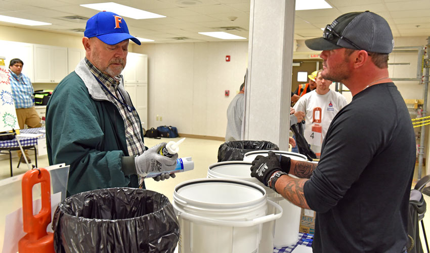 An attendee evaluates waste items as part of a waste-management exercise at the first annual Blue Grass Chemical Agent-Destruction Pilot Plant safety fair.