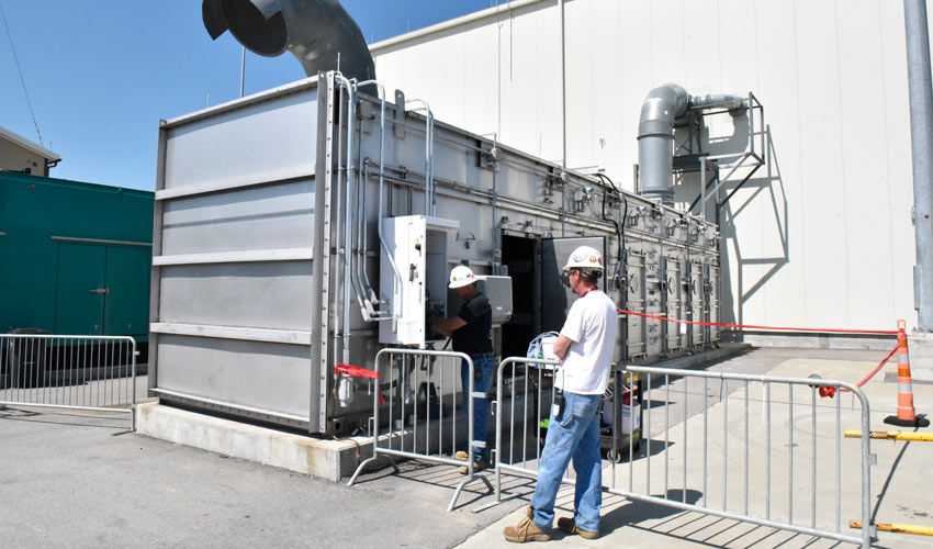 Technicians prepare the air filtration system for its first run at the Explosive Destruction Technology facility at the Blue Grass Chemical Agent-Destruction Pilot Plant.