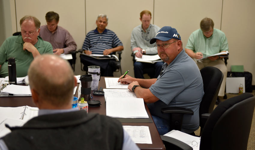 A team lead listens as a Hazard Event Analysis Review Team member provides input to a main process system assessment at the Blue Grass Chemical Agent-Destruction Pilot Plant June 5.