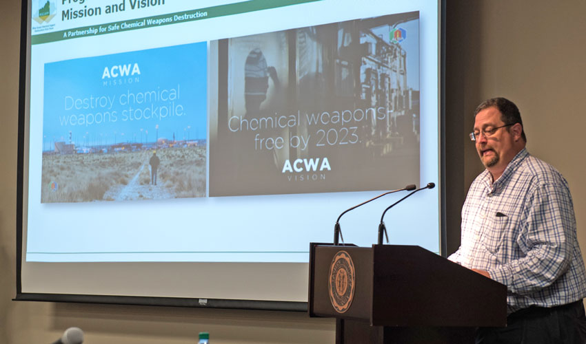Jeff Brubaker, site project manager, presents the new Program Executive Office, Assembled Chemical Weapons Alternatives mission and vision statements at the June 13 Kentucky Chemical Demilitarization Citizens' Advisory Commission and Chemical Destruction Community Advisory Board quarterly meeting.