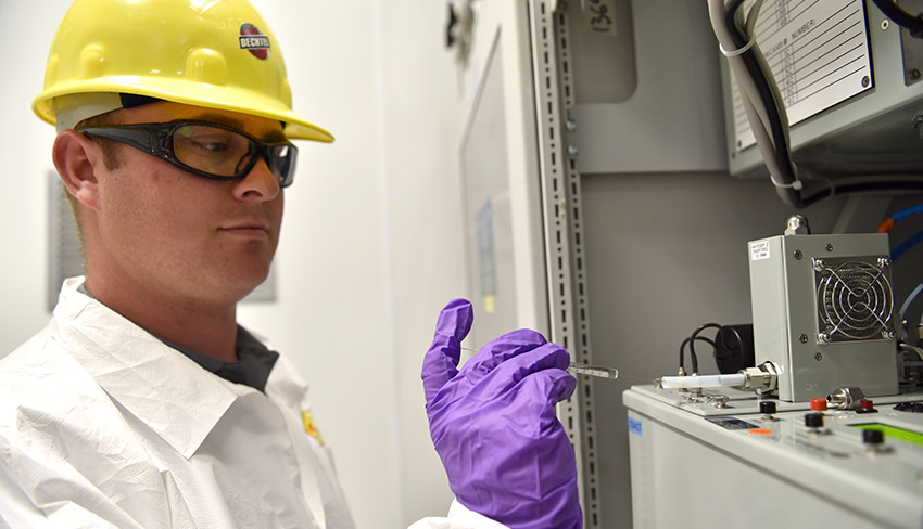 A Laboratory technician injects a sample to test Blue Grass Chemical Agent-Destruction Pilot Plant filter-bank monitoring equipment in June 2017.