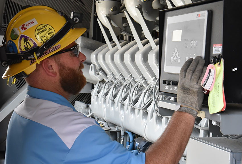 A systemization team member checks the output of one of the Blue Grass Chemical Agent-Destruction Pilot Plant's Standby Diesel Generators. The generators will provide back-up power to the plant in the event of a power loss.