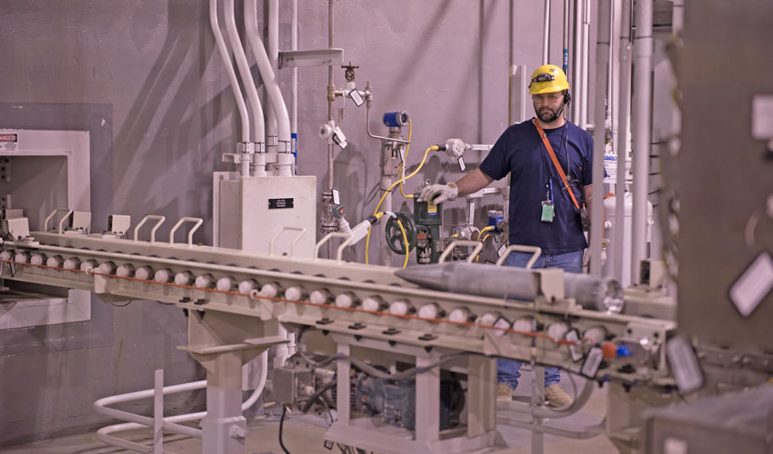 A technician watches as part of the Rocket Handling System is tested at the Blue Grass Chemical Agent-Destruction Pilot Plant. This system was turned over to operations earlier this year.