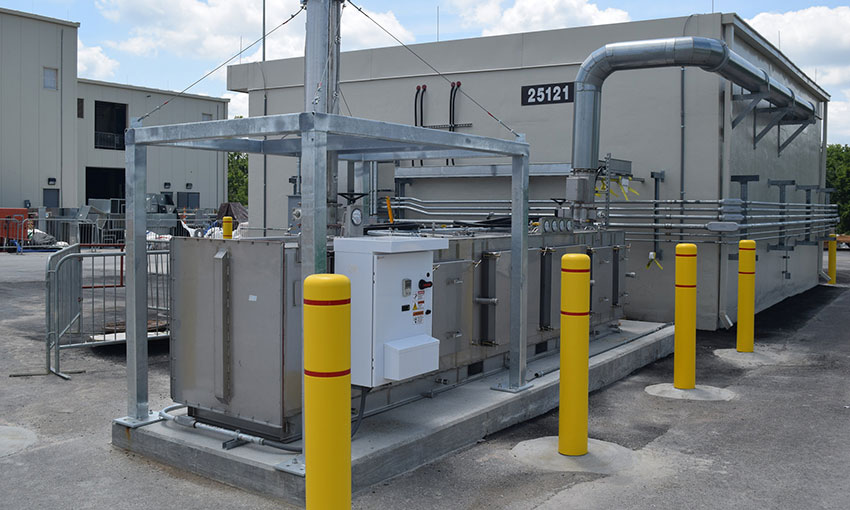 The carbon filtration system for the Explosive Destruction Technology Service Magazine pictured here has been installed and systemized. This filter provides engineering controls for the building and is required for the certification to store chemical weapons.