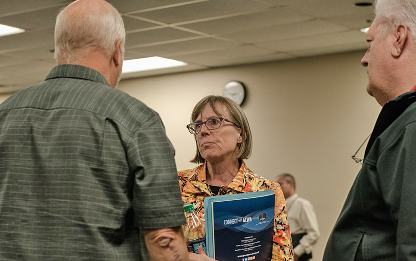 Suzanne Milchling, program executive officer, Assembled Chemical Weapons Alternatives, speaks with community members during the Kentucky Chemical Demilitarization Citizens' Advisory Commission and Chemical Destruction Community Advisory Board meeting Sept. 13.