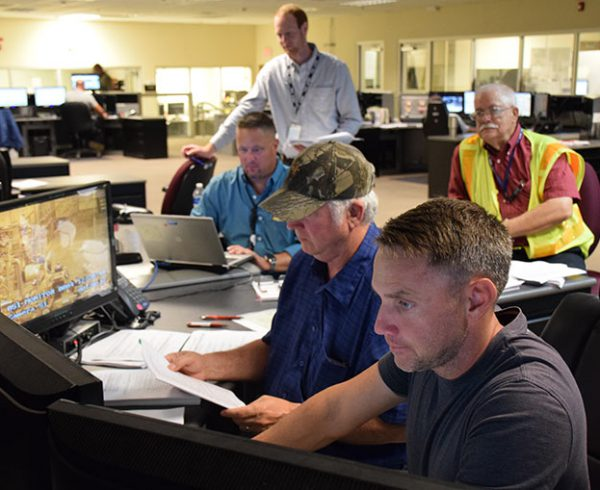 Control Room operators run the Agent Neutralization System systemization demonstration procedure as government observers take note. The system completed demonstration ahead of schedule on Aug. 30.