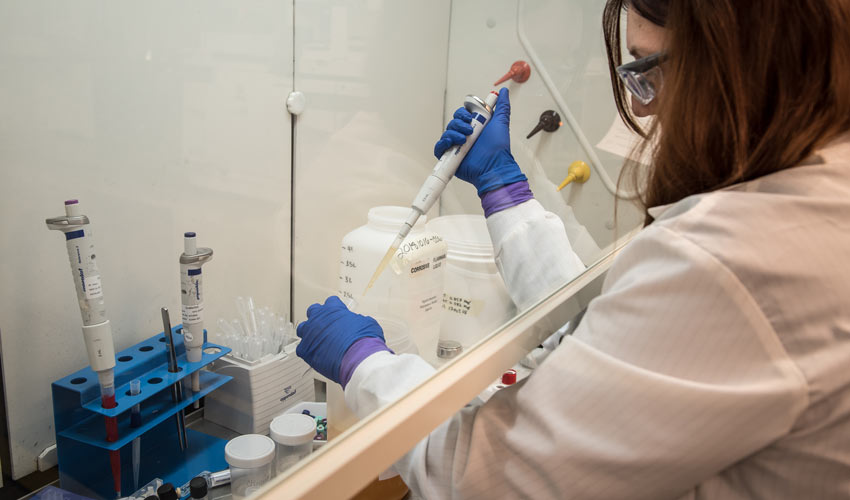 An analyst draws a sample of GB hydrolysate for testing purposes at the Blue Grass Chemical Agent-Destruction Pilot Plant Laboratory. The Lab is testing with munitions-grade hydrolysate to prepare for upcoming operations.