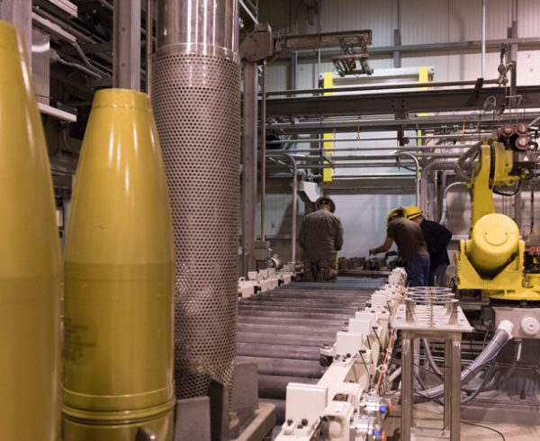 Technicians work on a munitions transfer tray during operations procedure testing for 8-inch inert projectiles at the Munitions Washout System at the Blue Grass Chemical Agent-Destruction Pilot Plant in May.