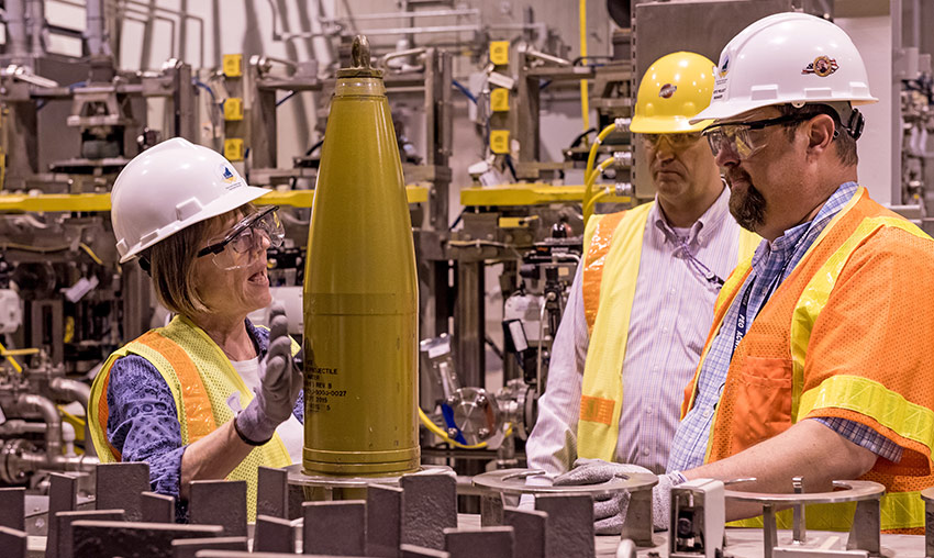 Suzanne Milchling, program executive officer, Assembled Chemical Weapons Alternatives, asks a question about projectile processing during a Blue Grass Chemical Agent-Destruction Pilot Plant tour Aug. 2.