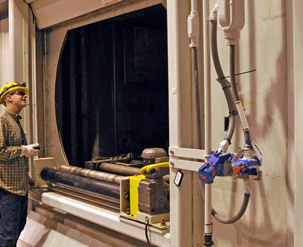 A Blue Grass Chemical Agent-Destruction Pilot Plant systemization team member watches a Metal Parts Treater airlock door operate during testing in March. Thorough testing, observation and notation are key components of the Pilot Test Demonstration Plan, required by regulators before pilot testing can begin.