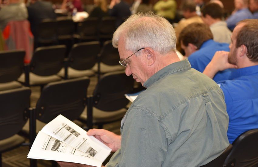 A member of the audience studies the Blue Grass Chemical Agent-Destruction Pilot Plant Year-in-Review presentation during the Kentucky Chemical Demilitarization Citizens' Advisory Commission and Chemical Destruction Community Advisory Board quarterly public meeting Dec. 9.
