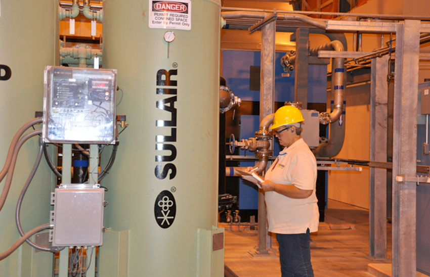 A Blue Grass Chemical Agent-Destruction Pilot Plant systemization team member checks steps on a compressed-air system test procedures checklist. This system will provide pressurized air for instrumentation, plant air and the plant's Life Support System.
