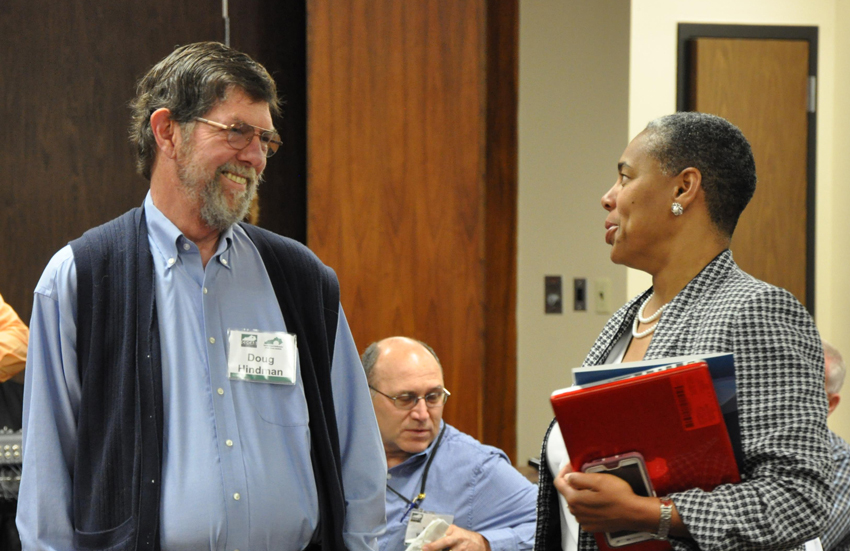 Dr. Doug Hindman, Kentucky Chemical Demilitarization Citizens' Advisory Commission (CAC) chair, left, chats with Sheila Pressley, CAC member, at a public meeting for the Blue Grass chemial munitions destruction project.