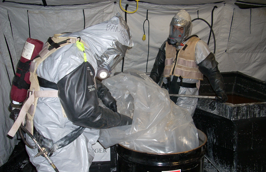Edgewood Chemical Biological Center (ECBC) technicians prepare a drum to properly receive process waste during the 2008-2009 Operation Swift Solution. ECBC personnel will return to the Blue Grass site to conduct the Explosive Destruction Technology treaty sampling operation.