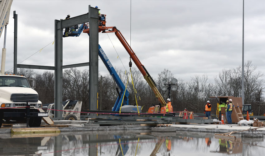 Workers install the first structural steel on the Explosive Destruction Technology Enclosure Building (EEB) at the Blue Grass Chemical Agent-Destruction Pilot Plant Dec. 29, 2015. The EEB will house the Static Detonation Chamber that is slated to destroy the mustard munitions in the Blue Grass stockpile.