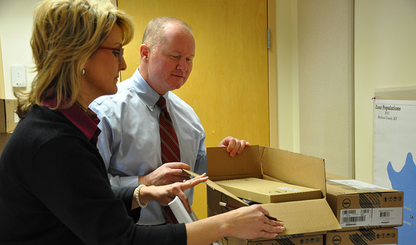 Howard Logue, director, and Kelley McBride, left, public information officer, both of the Madison County Emergency Management Agency (EMA), inspect equipment that will be installed in the soon-to-be-completed EMA headquarters building.