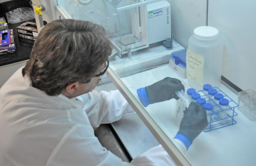 A Blue Grass Chemical Agent-Destruction Pilot Plant employee views test samples in the Laboratory. Edgewood Chemical Biological Center personnel will conduct agent analysis to fulfill Chemical Weapons Convention treaty requirements in a similar on-site laboratory, beginning in 2017.