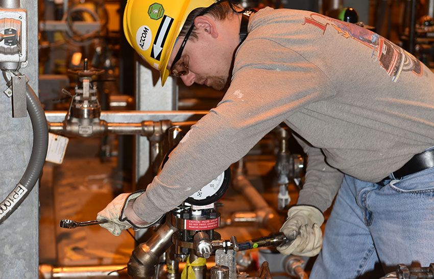 A systemization team member tests valving in the Supercritical Water Oxidation Processing Building in March 2016. The Blue Grass Chemical Agent-Destruction Pilot Plant has streamlined management for the systemization phase of the project.