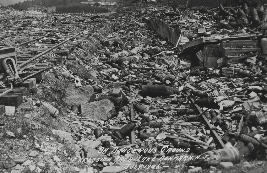 This postcard shows the destruction from a lightning-induced explosion that occurred at the Lake Denmark Naval Ammunition Storage Depot on the Picatinny Arsenal, New Jersey, on July 10, 1926. This explosion was the impetus for the formation of the Department of Defense Explosives Safety Board, which provides oversight to the United States' explosive storage and operations.