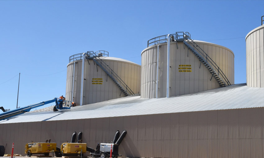 A scaffold enclosure surrounds Brine Concentrator Feed Tanks. The enclosure served as protection from weather during the installation of new coatings and will remain throughout plant operations to safeguard the coatings against inclement weather.