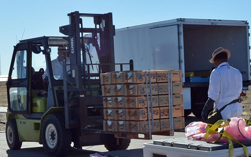 Toxic material handlers move 105mm boxed munitions out of storage at the U.S. Army Pueblo Chemical Depot for delivery to the Pueblo Chemical Agent-Destruction Pilot Plant.