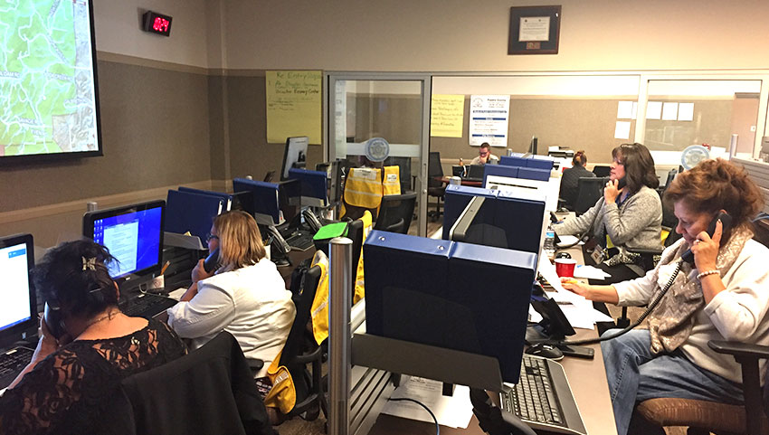 Volunteers answer questions related to the Junkins Fire, a 28-square mile fire that destroyed nine homes. During that event, the Joint Information Center was active for almost three days and responded to 502 calls.