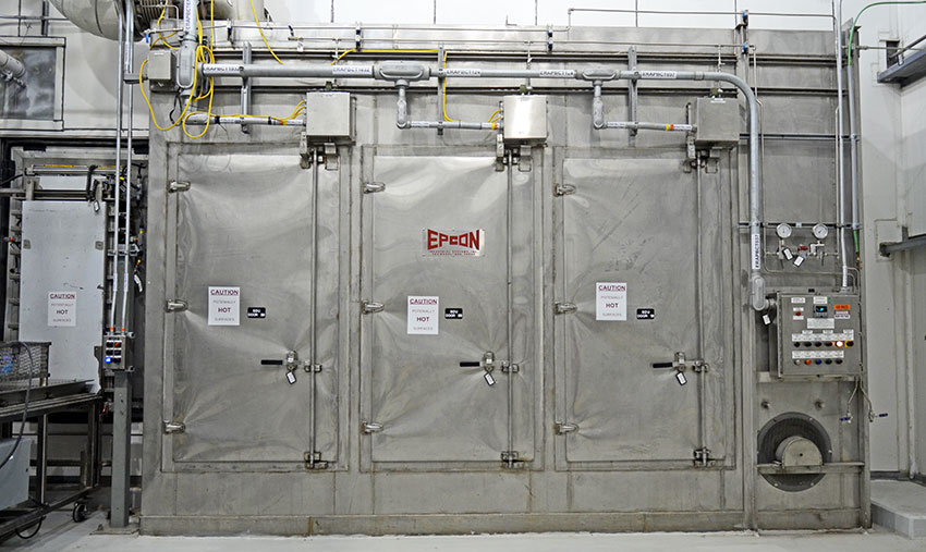 The Supplemental Decontamination Unit stands inside the Agent Processing Building of the Pueblo Chemical Agent-Destruction Pilot Plant. The system vaporizes agent from waste materials.