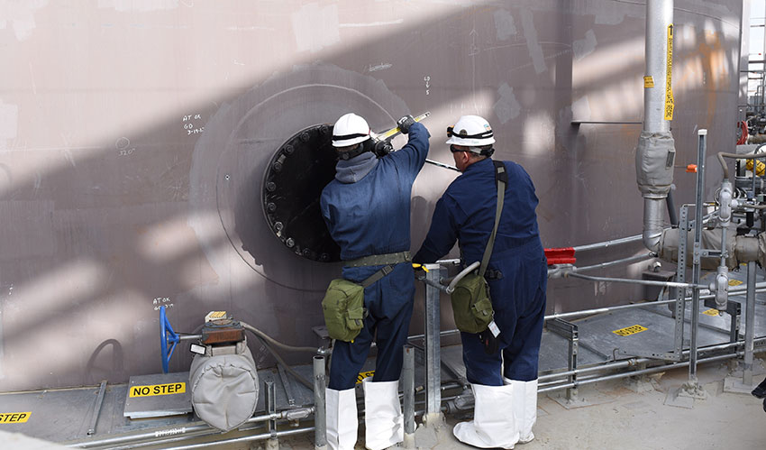 After removing its agitator, Pueblo Chemical Agent-Destruction Pilot Plant workers install a blind flange to one of three 30-day Hydrolysate Storage Tanks.