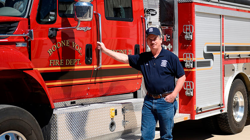 John Breckenridge stands in front of the Boone Firehouse, where he serves as volunteer fire chief. Breckenridge is also a mechanical technician at the Pueblo Chemical Agent-Destruction Pilot Plant.