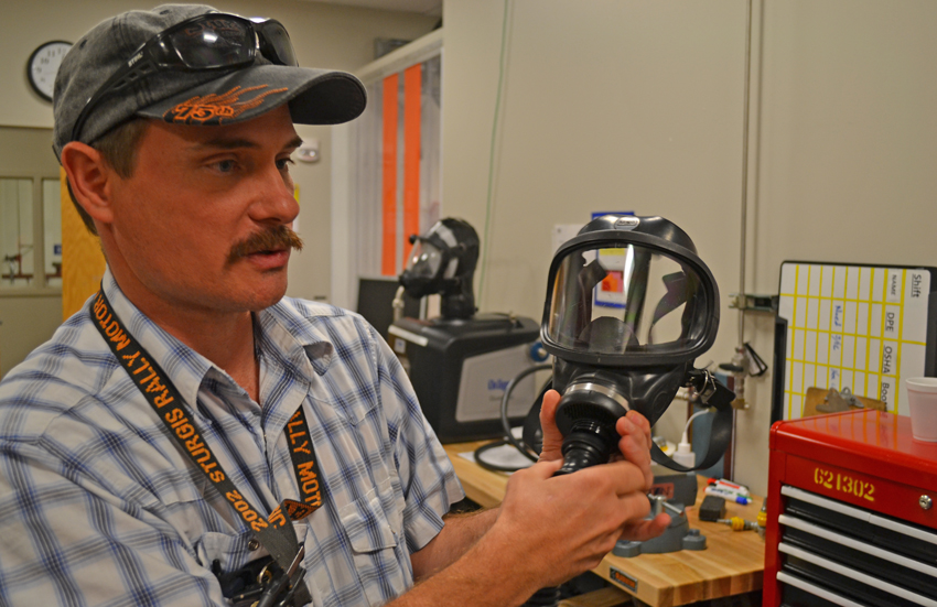 On Aug. 25, training specialist Bret Peterson holds a Mine Safety Appliance at the plant's training facility. This type of mask will be used by employees who make toxic area entries at the Pueblo Chemical Agent-Destruction Pilot Plant.