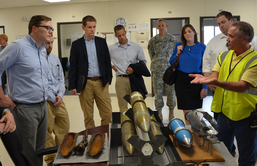 Steve Bird, right, describes how the Pueblo Chemical Agent-Destruction Pilot Plant Explosive Destruction System destroys munitions to U.S. House of Representatives staff members during a June 30 tour.