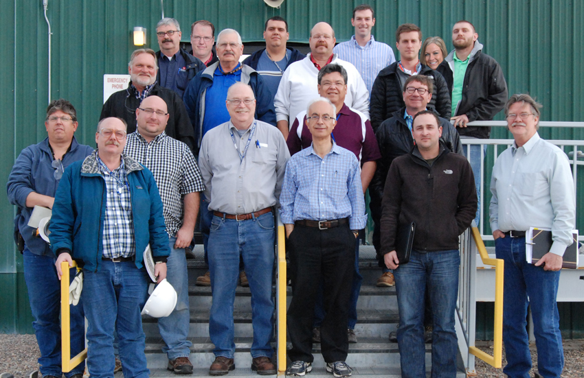 The cognizant systems engineer team poses for a photo in front of the Personnel Support Building at the Pueblo Chemical Agent-Destruction Pilot Plant. They will ensure the systems, subsystems, and first-of-a-kind equipment at the plant performs as designed prior to and during operations.