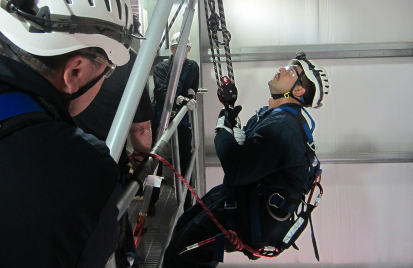 A member of the Pueblo plant's Delta Crew practices a high-angle rescue. The Emergency Response Team members are trained in three types of rope rescue: high angle, low angle and confined space.
