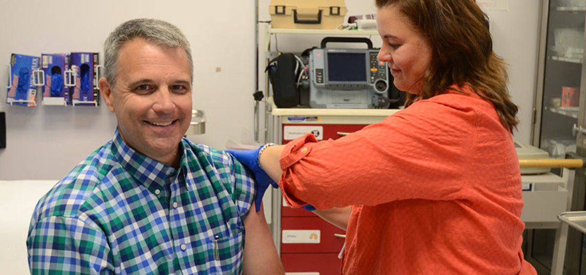 Bechtel Pueblo Team project manager Rick Holmes receives an influenza vaccine from continuous quality improvement nurse Jennifer Wilson. The Pueblo plant's medical clinic offers a broad range of services, from flu shots to advanced life support.