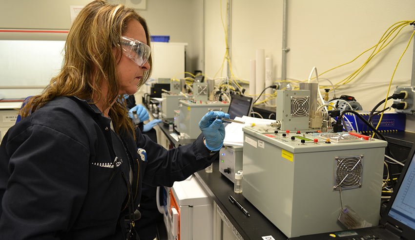 A monitoring technician calibrates air monitoring equipment at the Pueblo plant. All positions that require routine access to chemical munitions or agents must meet the high standards of the Army's Chemical Personnel Reliability Program.