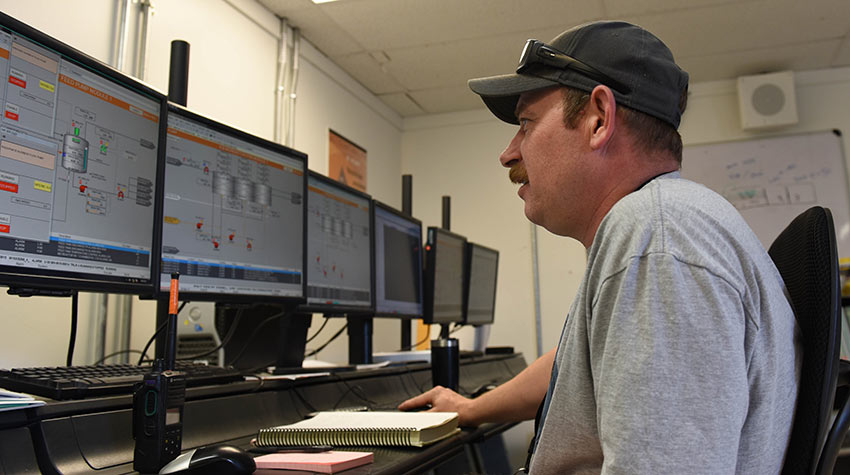 An operator monitors a biomass feed from the Biotreatment Area Control Room at the Pueblo Chemical Agent-Destruction Pilot Plant.