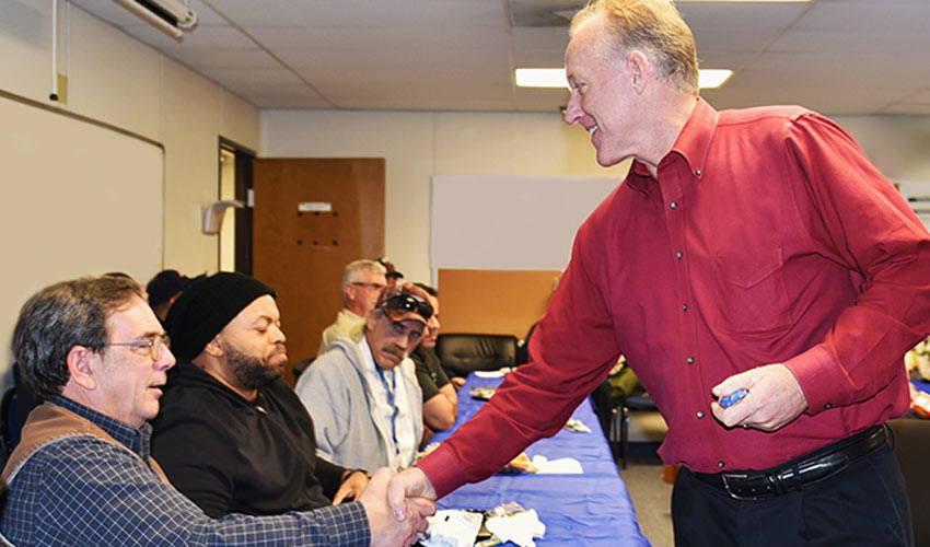 Bret Griebenow, project manager, Bechtel Pueblo Team, right, hands out tokens of appreciation to Pueblo Chemical Agent-Destruction Pilot Plant veterans during an appreciation event on Nov. 9.