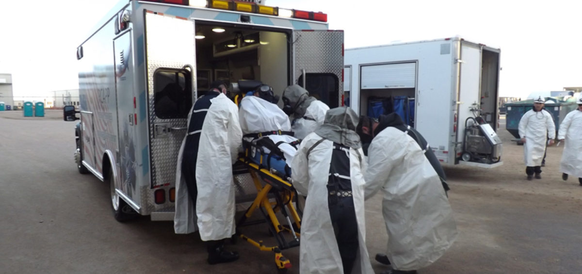 Pueblo plant staff performs drills to demonstrate their readiness for operations. In this scenario, an employee who has been exposed to mustard agent is being lifted into an ambulance for transport to the Pueblo plant's Medical Clinic.