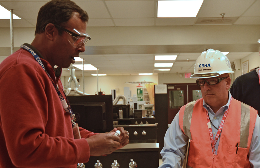 Brad Baptiste, right, Occupational Safety and Health Administration (OSHA) manager, speaks with Brian Ramdwar, operations branch manager, about Laboratory testing. Baptiste was among several auditors who spent the week at the Pueblo plant reviewing the organization for the OSHA Voluntary Protection Program's Star Status.