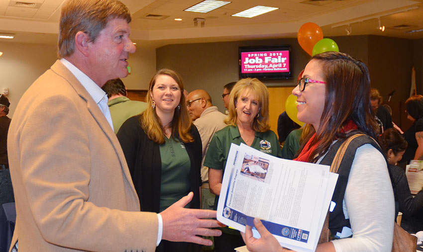 U.S. Rep. Scott Tipton (R-Colo.) greets a job fair attendee as Pueblo plant human resources staff looks on. Approximately 150 job seekers spoke to PCAPP human resources staff at the Pueblo Community College Spring Job Fair, sponsored in part by Tipton.