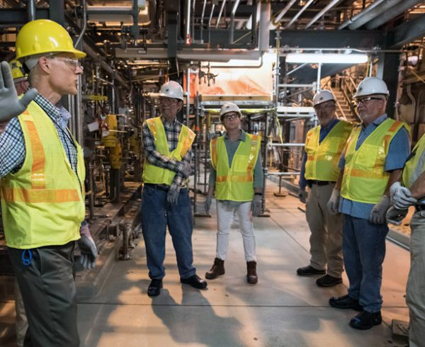 In this file photograph from August 2018, Dr. George Lucier, deputy chief scientist, Bechtel Parsons Blue Grass, explains to members of a public working group the rerouting of piping in the Supercritical Water Oxidation Processing Building to prepare for the possibility of hydrolysate shipment at the Blue Grass Chemical Agent-Destruction Pilot Plant. The decision was made in August 2020 to ship the hydrolysate to a permitted disposal facility for final destruction.