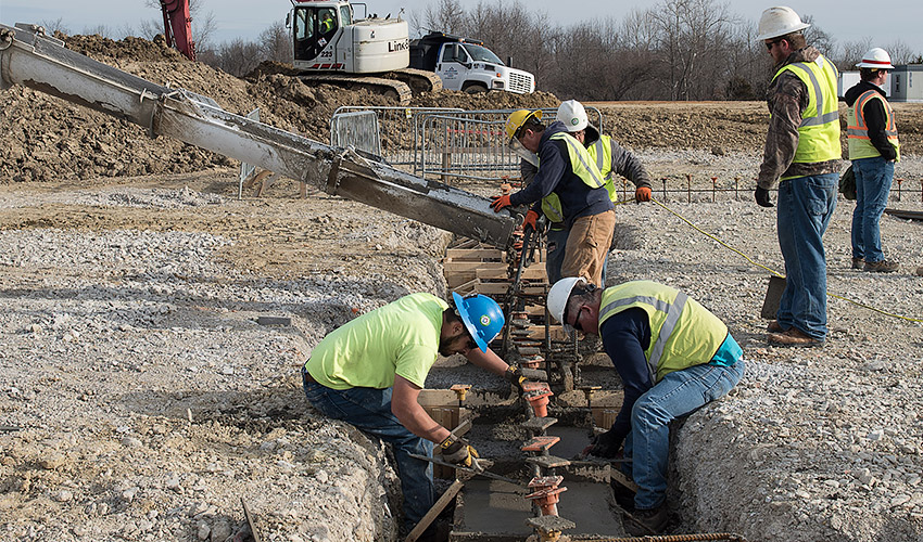 Workers place the first concrete on the Static Detonation Chamber 2000 site at the Blue Grass Chemical Agent-Destruction Pilot Plant March 9, 2020. The placement is for foundation footers for the site's Personnel Support Building.