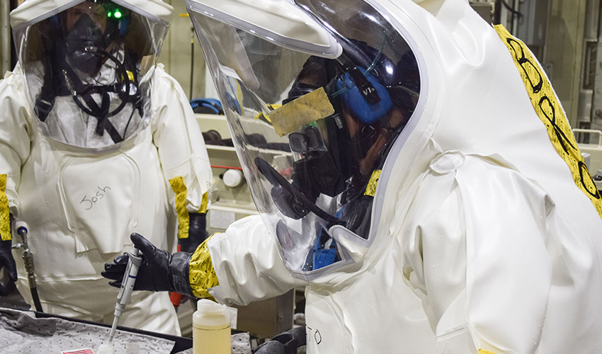 Toxic Area entrants wearing protective gear take a treaty sample during a training exercise in August 2019 at the Blue Grass Chemical Agent-Destruction Pilot Plant. The training was in preparation for the first GB agent sampling operation conducted March 24.