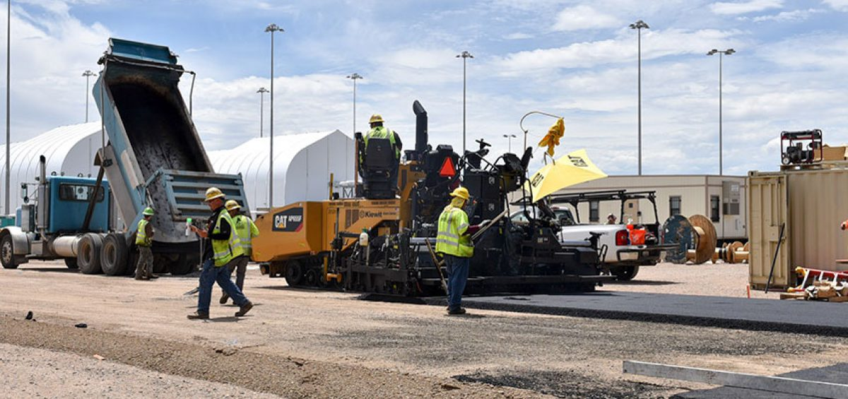 Crews lay asphalt on July 23 at the Pueblo Chemical Agent-Destruction Pilot Plant's Static Detonation Chamber site