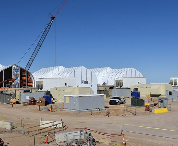 Sprung structures rise at the Static Detonation Chamber site at the Pueblo Chemical Agent-Destruction Pilot Plant. Three SDC units have been assembled to augment the main facility and destroy problematic munitions.